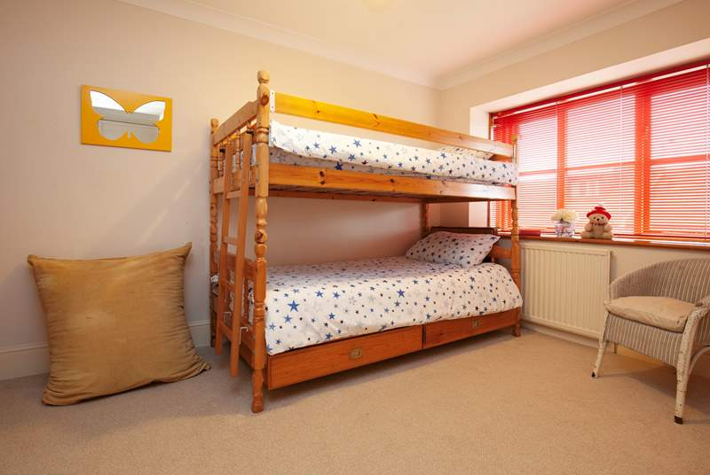 The cheerful bunk room is perfect for children.
