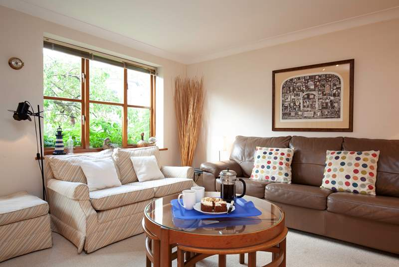 The sitting-room is bright and comfortable, with plenty of space for the entire family.