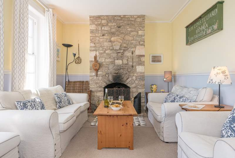 Large living room with open fire and windows offering superb views