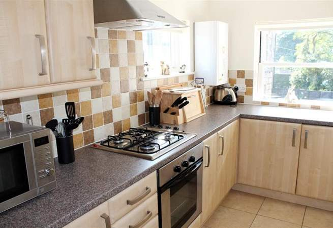 The kitchen is fully equipped and modern.