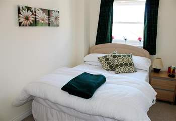 The comfortable main bedroom.