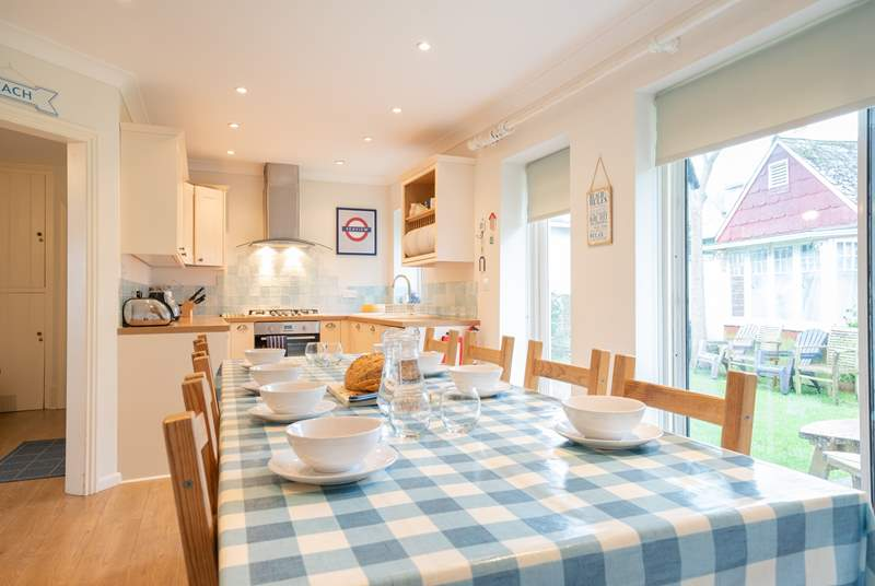 The kitchen/dining-room opens out to a lovely private enclosed garden.