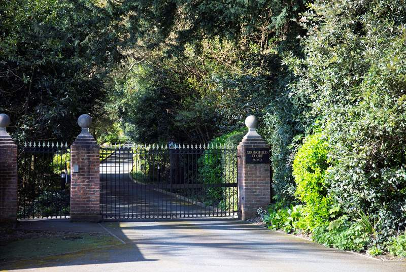 The picturesque drive through the grounds and up to the property starts at the automatic gates.