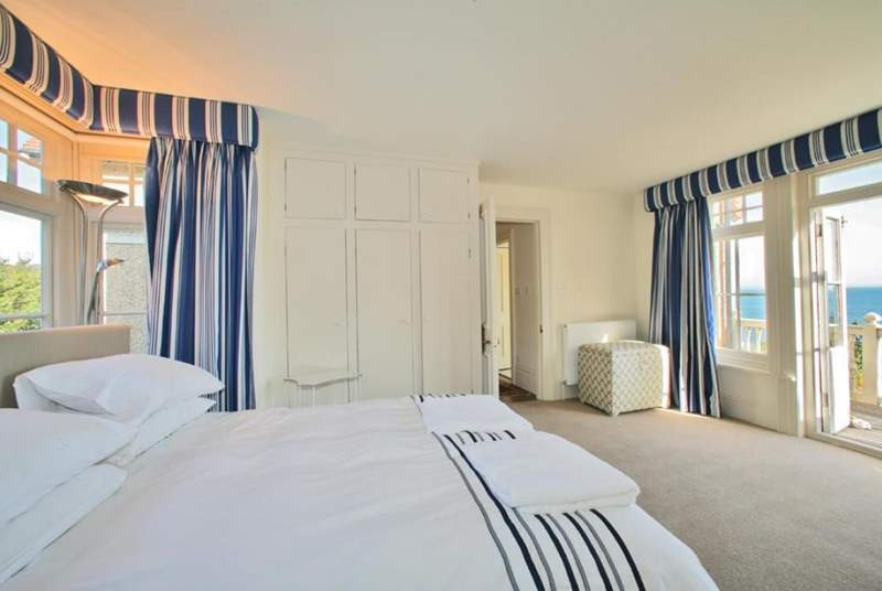 The master king-size bedroom has doors to the balcony overlooking Seagrove Bay.