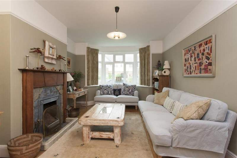 Comfortably furnished, the living-room offers a cosy and peaceful setting to unwind.