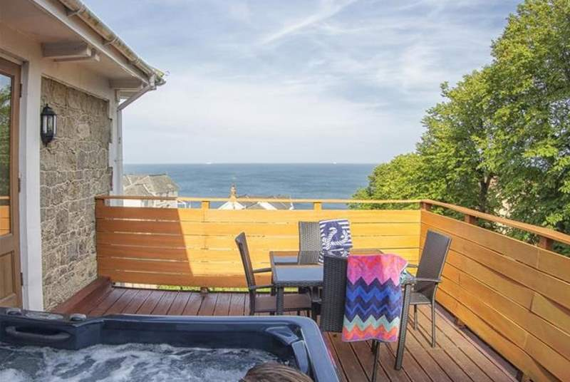 Enjoy a soak in the hot tub with sea views.