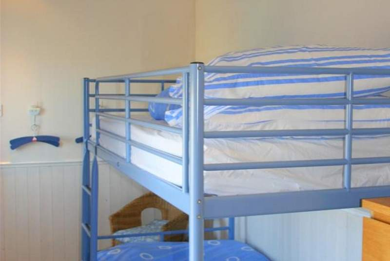 The bunk bedroom is suitable for children or adults.