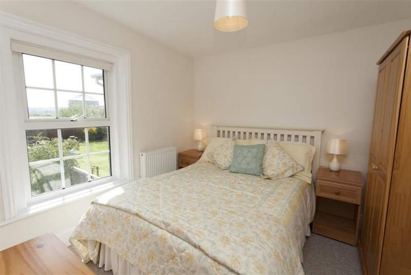 The main bedroom overlooks the garden.