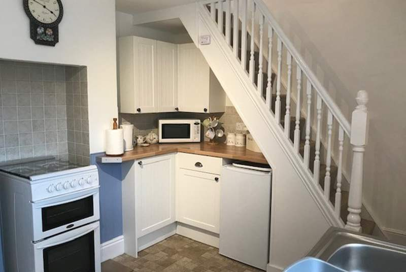 The compact kitchen/diner. Please note that the stairs are quite narrow.
