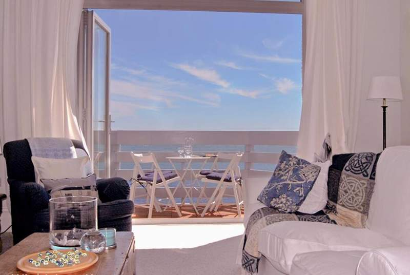 The sitting-room has a balcony with fabulous sea views.