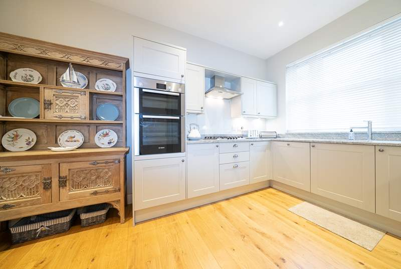 The lovely kitchen offers plenty of space and light.