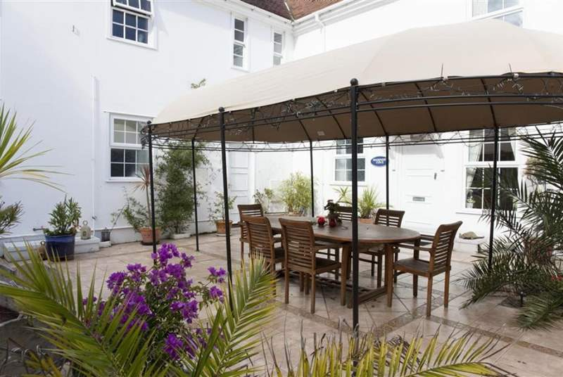 The Spanish-style courtyard dining-area.