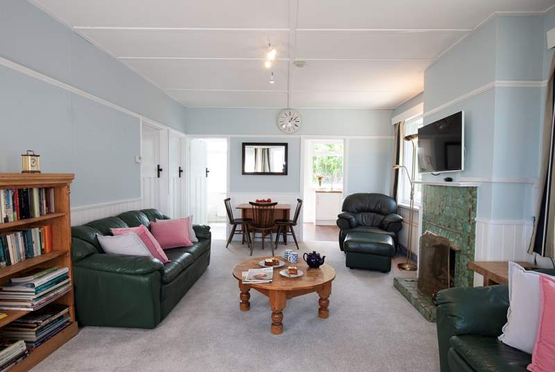 The bright sitting room has plenty of comfortable seating.