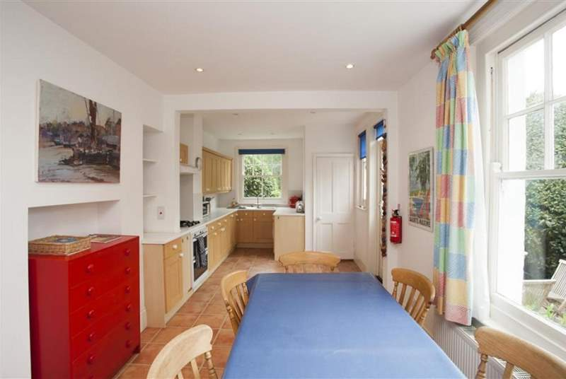 The large open plan kitchen and dining area has a door out to the rear enclosed garden.