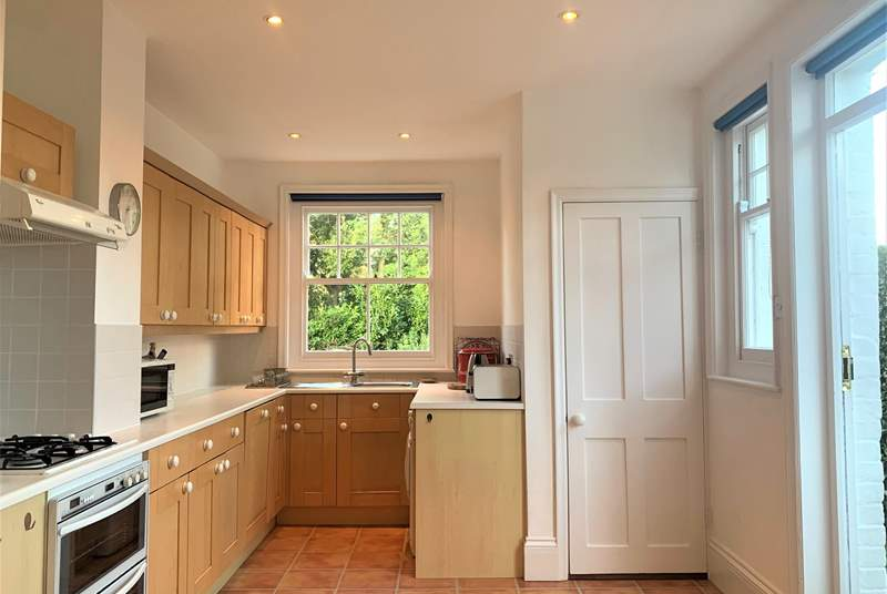 The open plan kitchen and dining area has a door out to the rear enclosed garden.