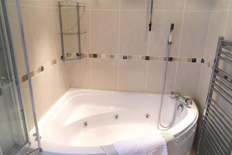 Bathroom with spa bath.