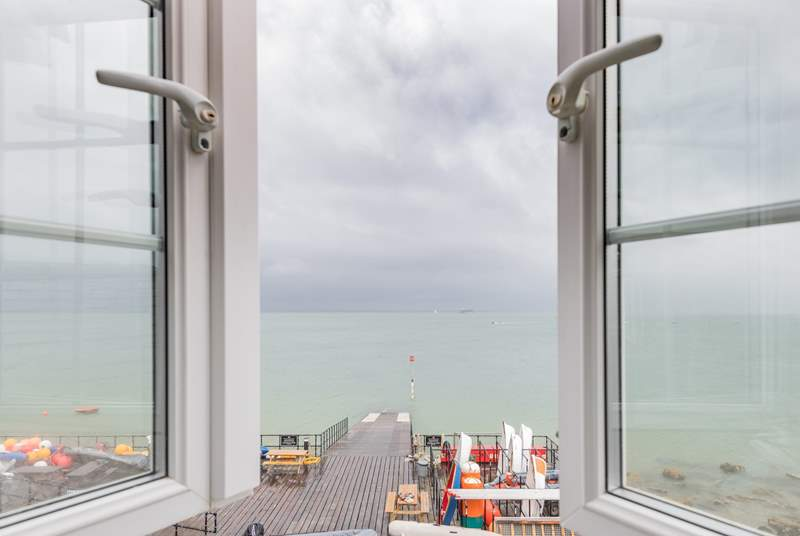 A bedroom with a stunning view, watch the sailing world go by