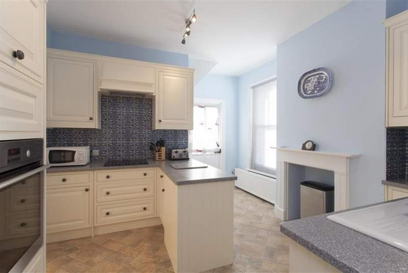 The bright and airy kitchen which leads to the rear garden.