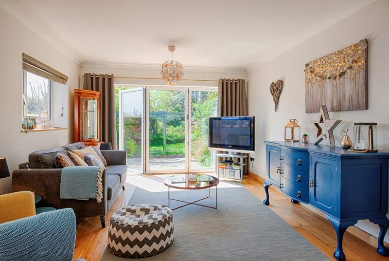 Enjoy the view out to the garden from the comfort of the sitting-room