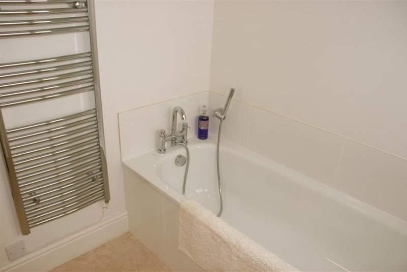 Family bathroom with heated towel rail.