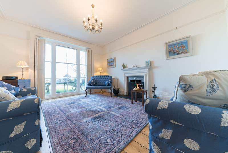 The elegant and spacious sitting-room with open fire.
