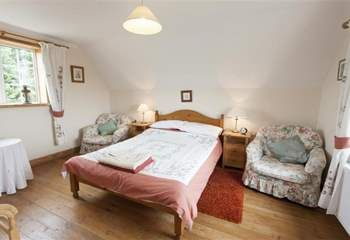 The main bedroom with views on both sides across the countryside.