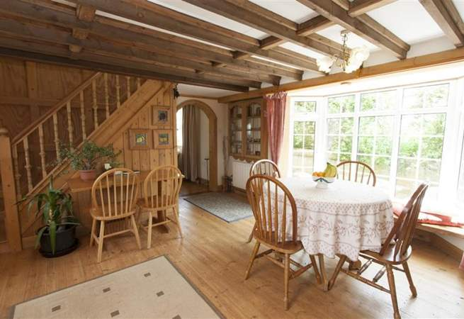 Lovely cottage with an open plan living room and stairs to first floor.