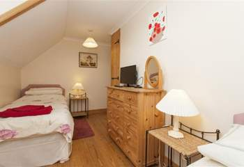 Twin bedroom with additional pull out single beds.