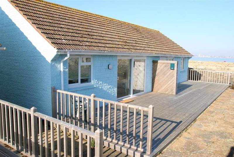 This compact bungalow is just steps from the sea.