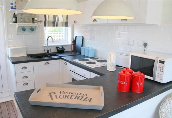 The well-equipped kitchen is a pleasant place to prepare meals.