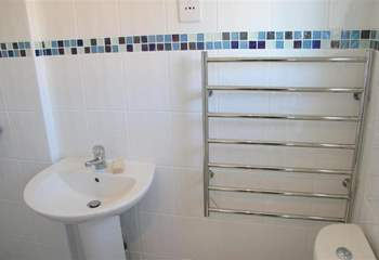 The bathroom features a modern walk-in shower.