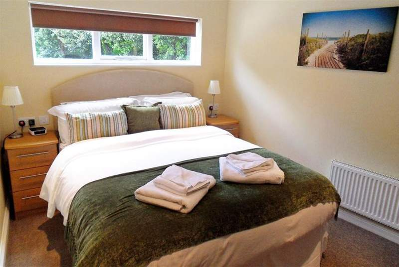 The mezzanine bedroom is reached by a set of stairs and there is a king-size and single bed.