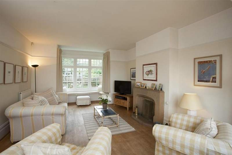 The comfortable living area has an open fireplace and sea views.