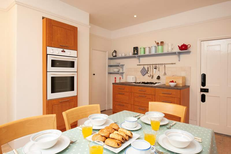 The kitchen/dining-room is spacious and well-equipped.