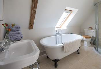 The en suite bathroom for the master bedroom with corner shower cubicle.