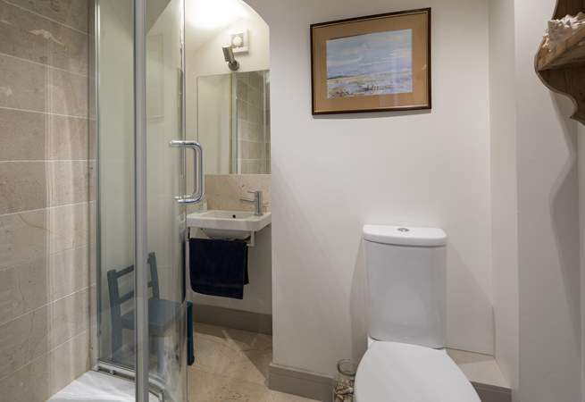 This ground floor shower-room is adjacent to the playroom/snug, which is behind the kitchen.