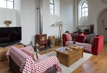 This wonderful open plan sitting-room has a cosy wood-burner for cooler evenings.