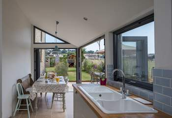 The dining-area has bi-fold and tri-fold doors, that open to bring the outside in.