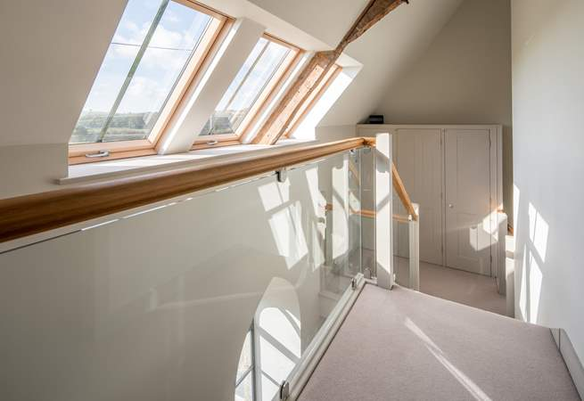 The first floor landing is flooded with light and reveals the structure of this beautiful renovation.