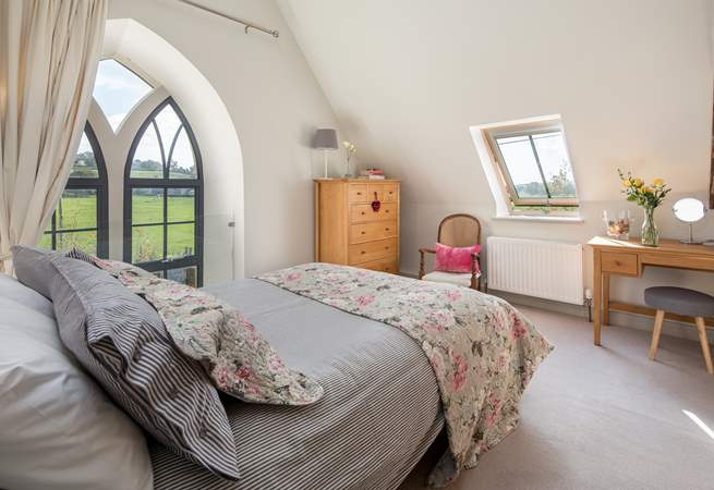 The master bedroom has this beautiful feature window, protected by a glass safety screen.