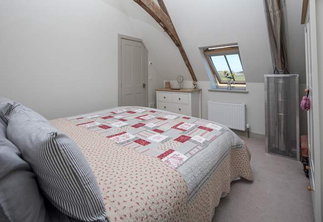 Bedroom 2 has an en suite shower room and a safety cage protects the flue that comes up from the wood-burner below.