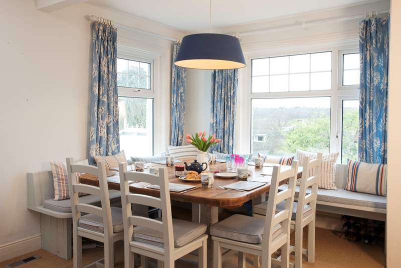 Lovely large dining-table with plenty of space for family meals.