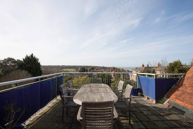 A lovely roof terrace perfect for al fresco dining in the sunshine and surrounded by views across to The Solent and nearby nature reserve.