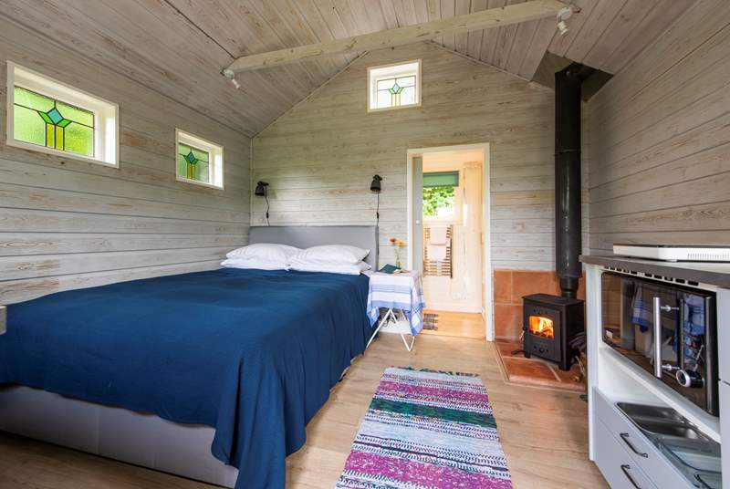 The king-size bed and cosy wood-burner make this a perfect retreat in the winter too.