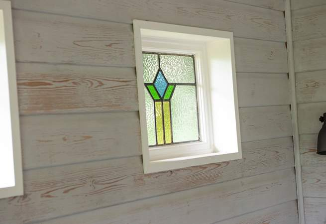 These upcycled windows bring a beautiful light into the cabin.