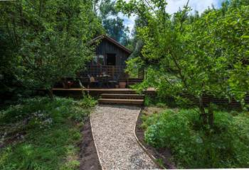 The cabin is tucked away at the back of the orchard and feels very private. You will need to carry your bags up from the parking space.