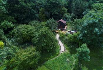 An aerial view that shows the cabin at the top of the orchard.