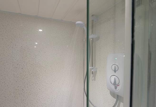 The electric shower gives instant hot water.