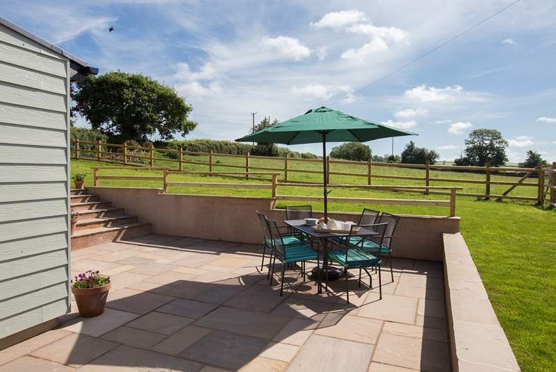 There is a panoramic view across the fields for miles from the patio and enclosed garden-area above it.