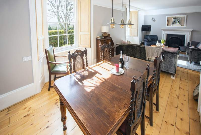 The more formal dining-area overlooks the rear garden and estuary and is the perfect spot for a leisurely dinner.